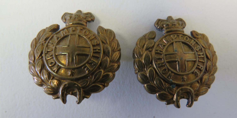 Pair of Victorian Northamptonshire Regiment Collar Badges