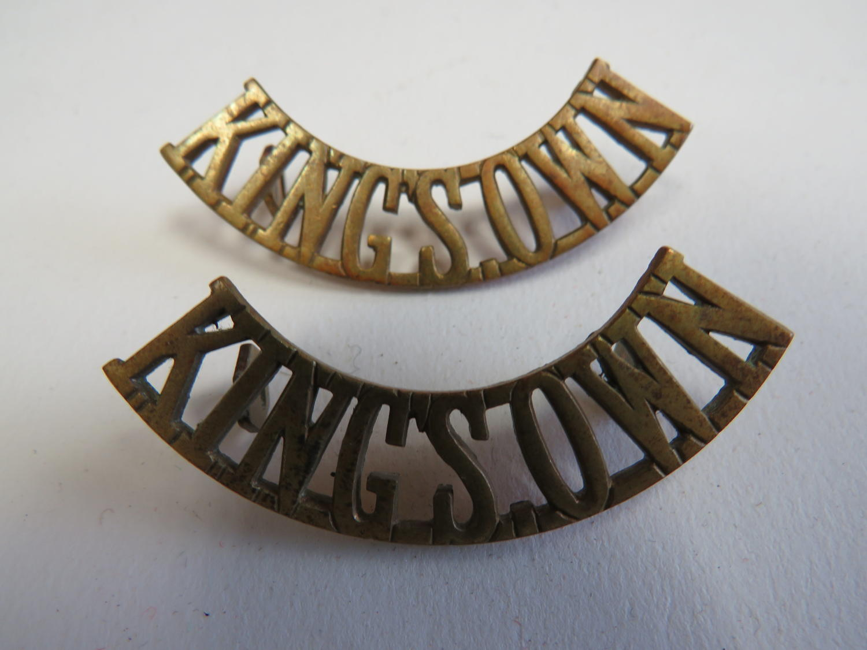 Pair of Kings Own Brass Shoulder Titles