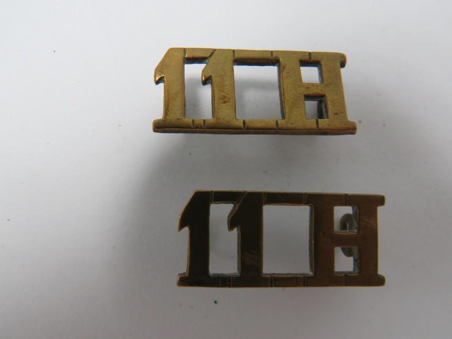 Pair of 11th Hussars Shoulder Titles
