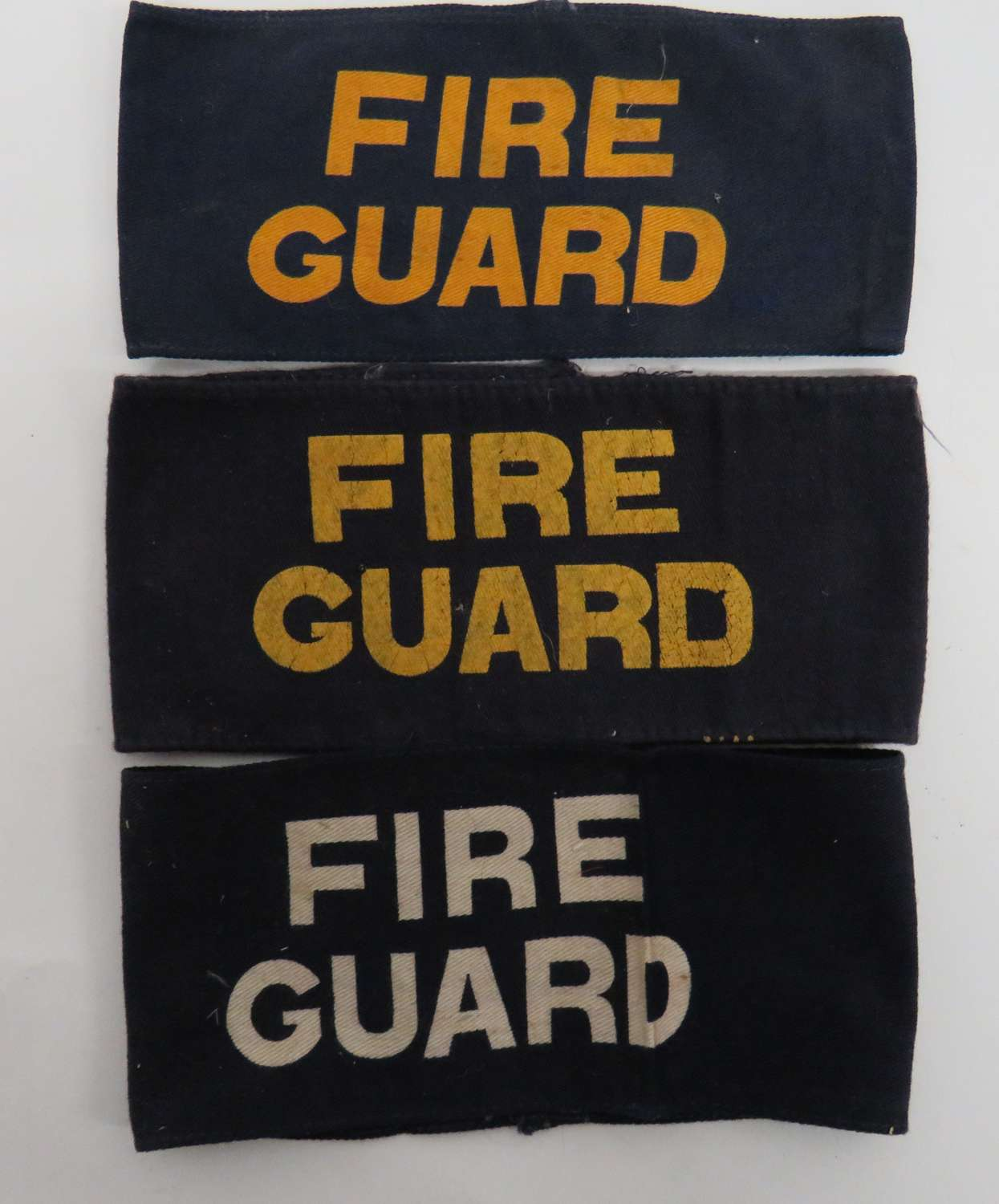 Three Various Fire Guard Armbands