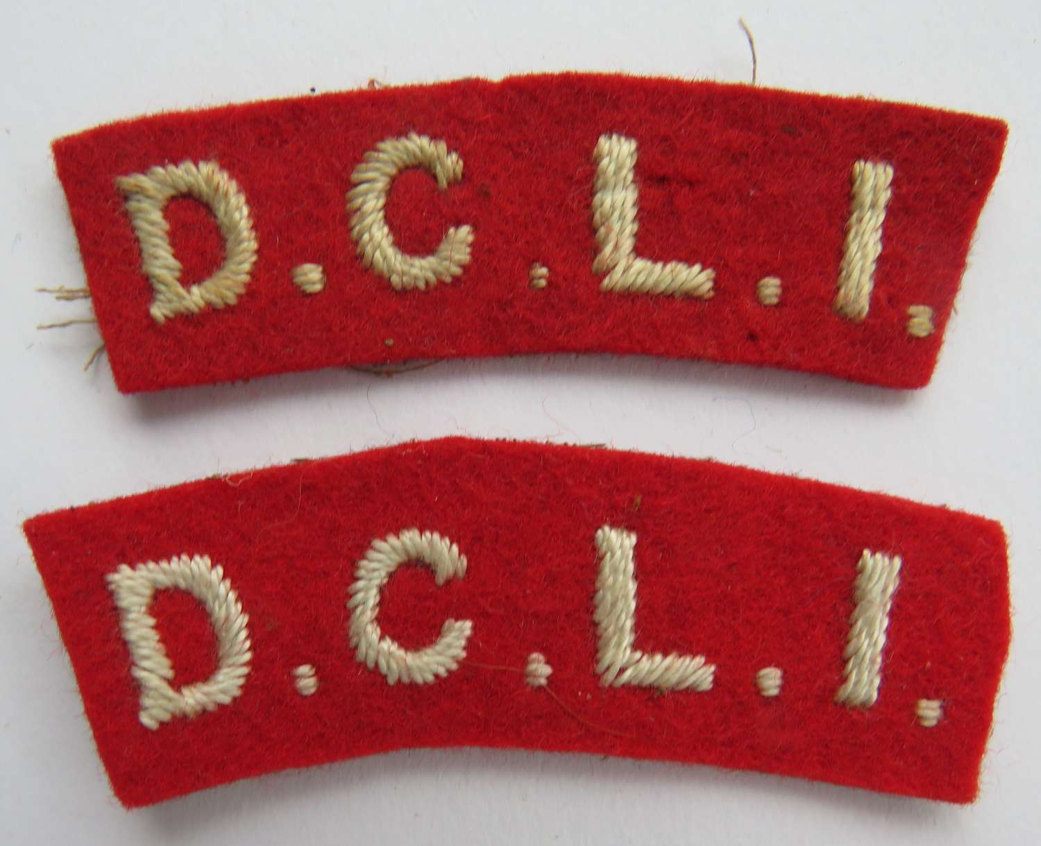 Pair of D.C.L.I Shoulder titles
