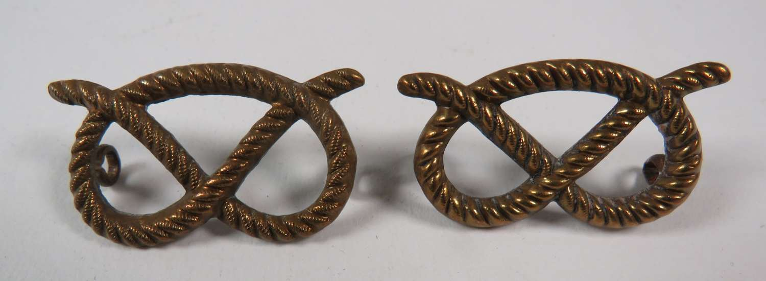 Pair of South Stafford Collar Badges