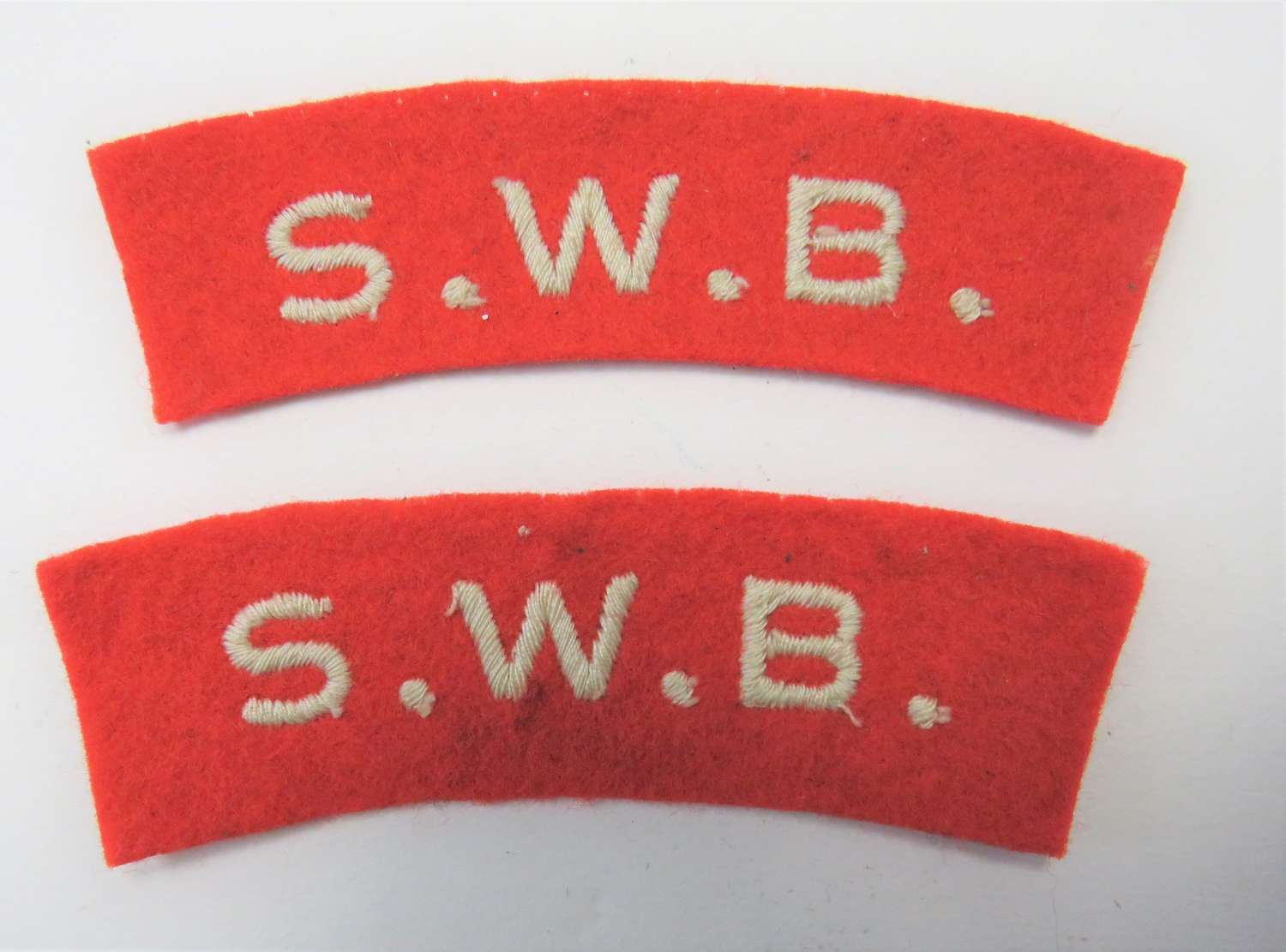 Pair of South Wales Borderers Shoulder Titles