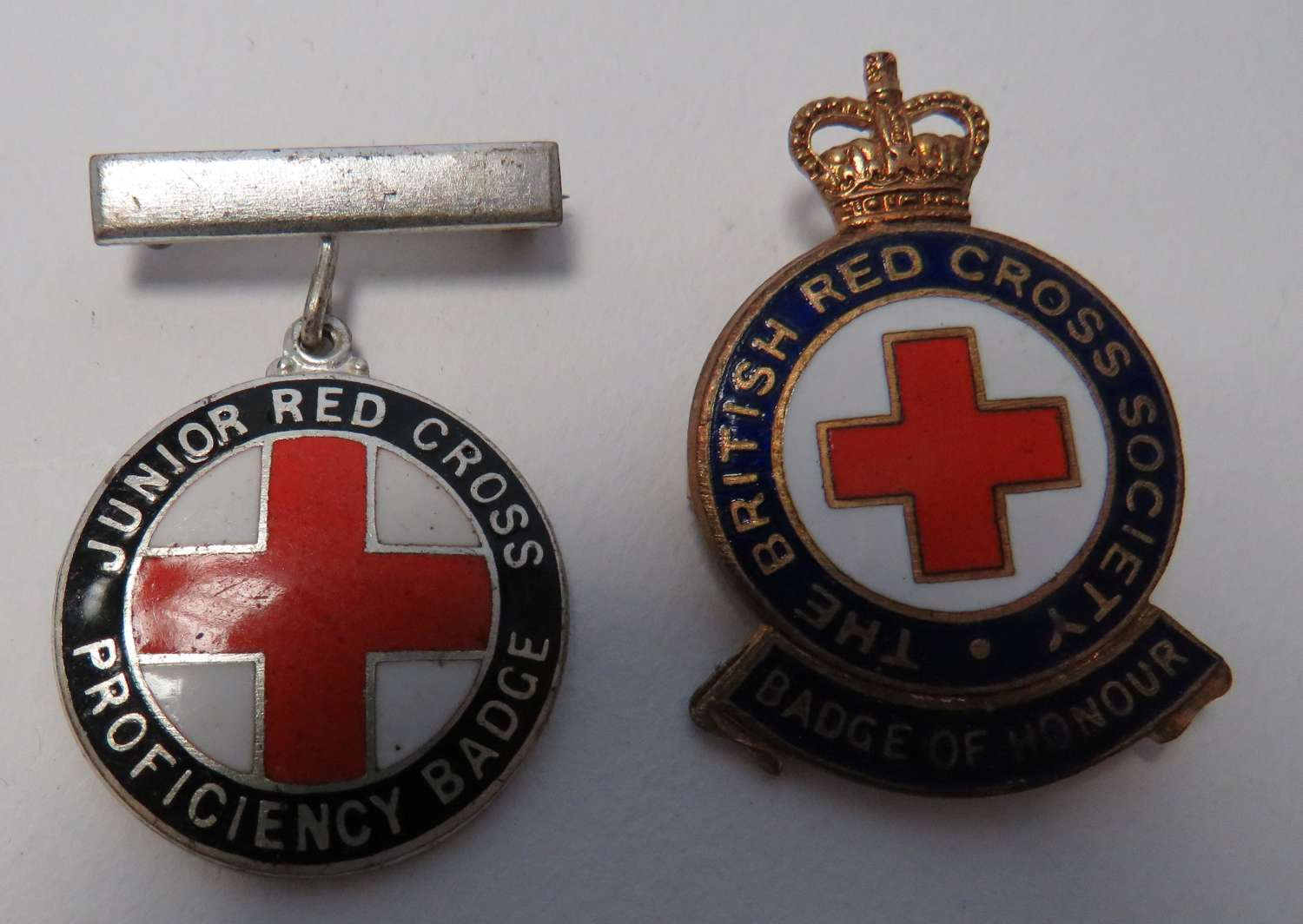 Two Red Cross Badges